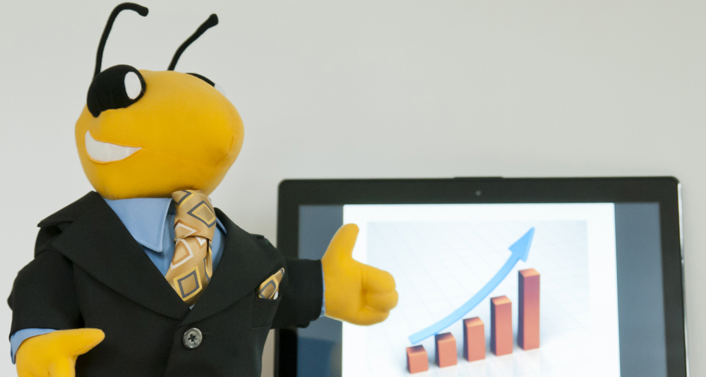 Buzz doing a business presentation with a bar chart