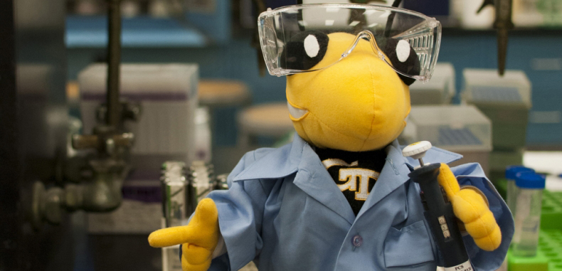 Buzz in Laboratory dressed in Lab Coat