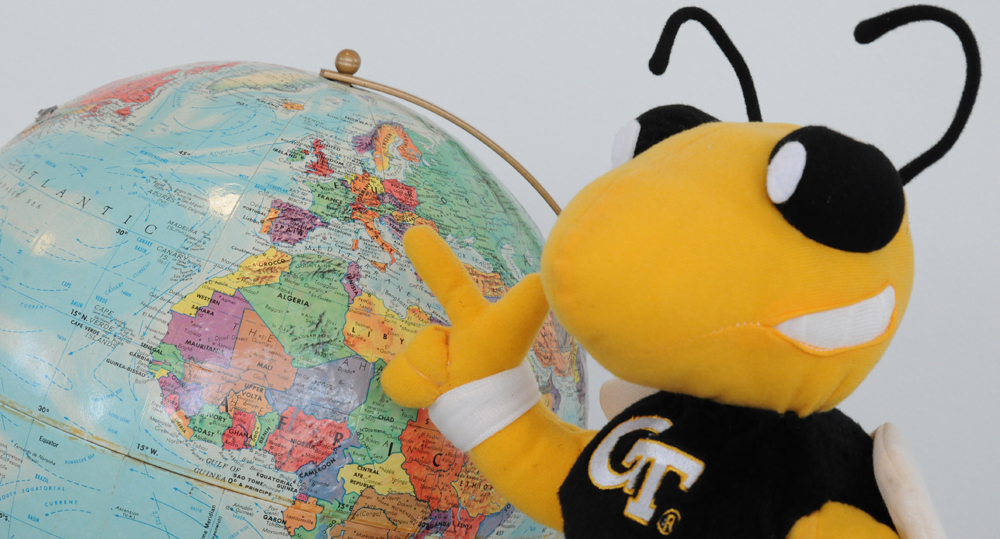 Buzz Pointing to Globe