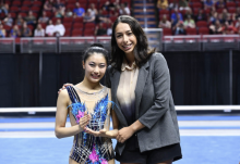 Elena Shinohara receives the Sportsperson of the Year Award from Rebecca Sereda (Credit: USA Gymnastics)
